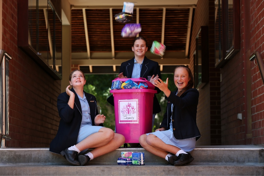 Phebe Harvey, Brianna Goldsworthy and Tatum Wolmarans (all y9s) Iona girls helping homeless women by donating tampons and pads.
