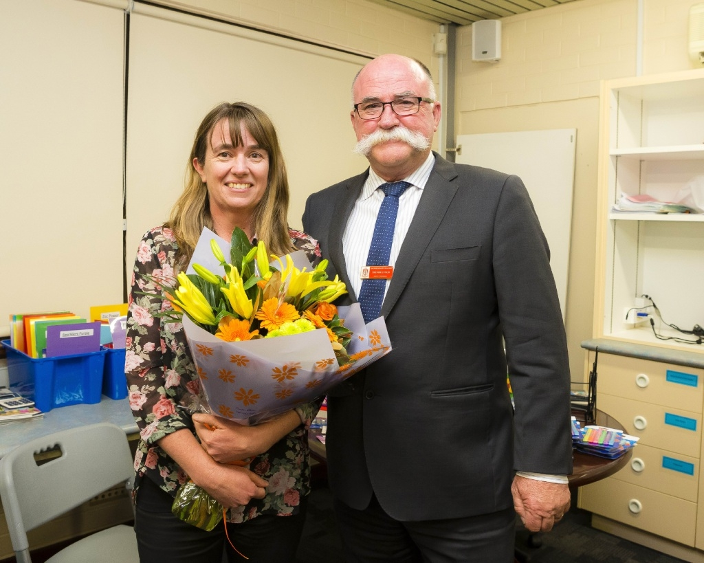 A Day Made Better winner Marie Blackburn and acting principal Trevor Lynch at her surprise celebration.