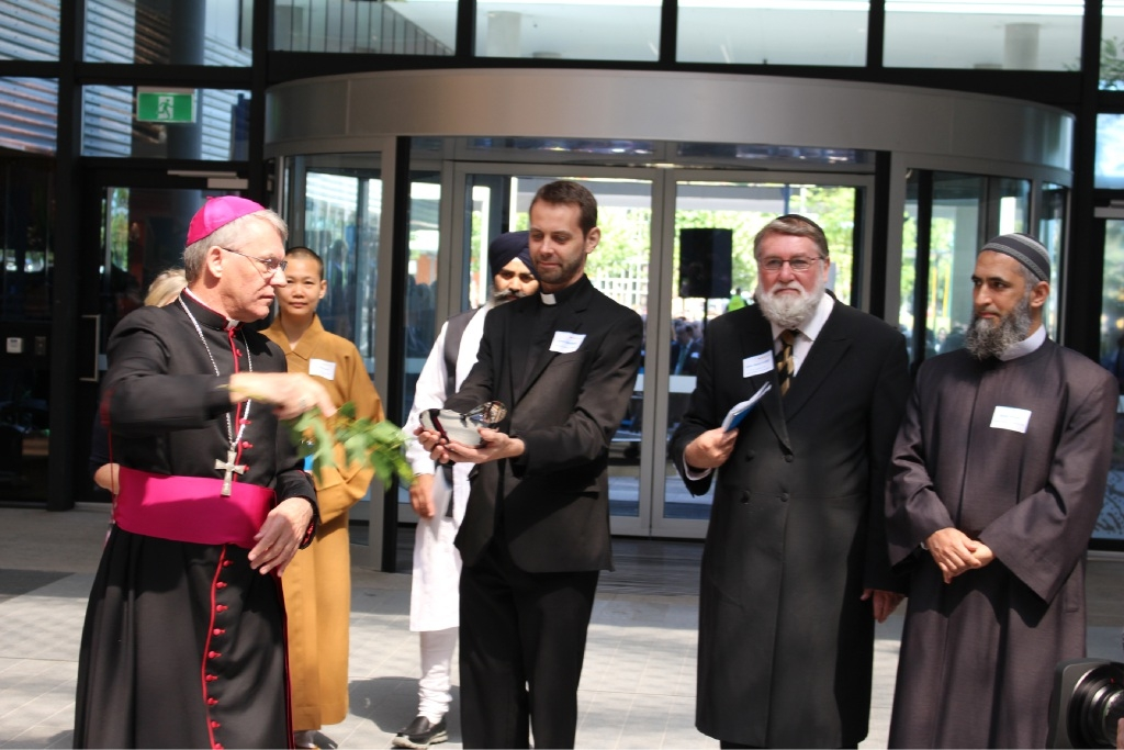 Archbishop Timothy Costelloe blesses the new hospital in the presence of leaders of other faiths.
