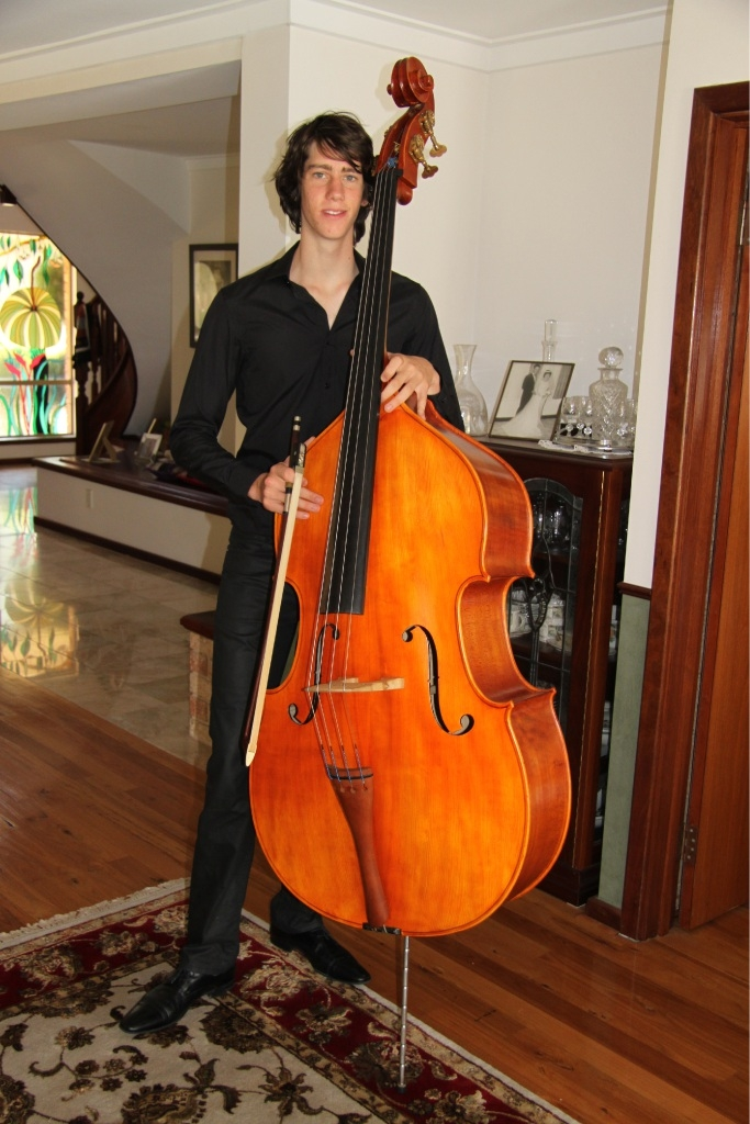 Taigh Macdonald with his double bass, the largest instrument in the string family.