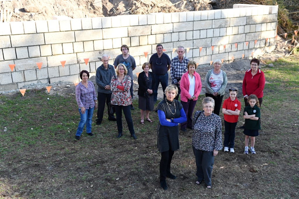 Disgruntled residents in front of a retaining wall for the new concrete batching plant. In the foreground are Sally Palmer and Karen Ring. Picture: Marcus Whisson       www.communitypix.com.au   d438591