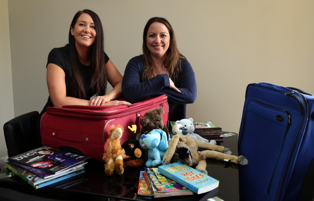 Kate Bergersen and Claire Rogerson aim to help orphans in Guatemala. Picture: Martin Kennealey www.communitypix.com.au d447148