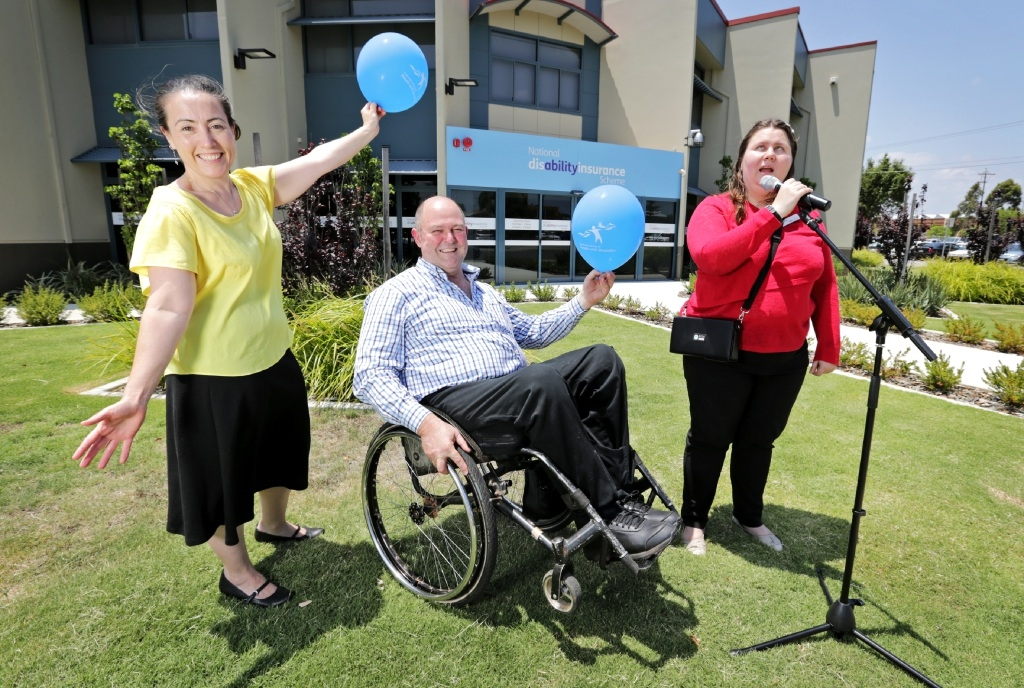 Ready to celebrate: Mary Ashe and Grace King from NDIS with celebration organiser Jim Cairns. Picture: David Baylis    d446953