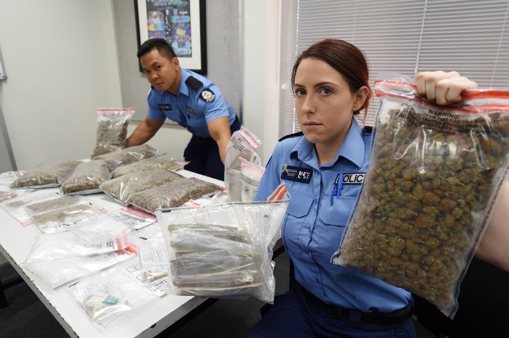 Constable Miguel De Guzman and Constable Sarah Behan with the seized drugs.   Picture: Jon Hewson www.communitypix.com.au   d447197