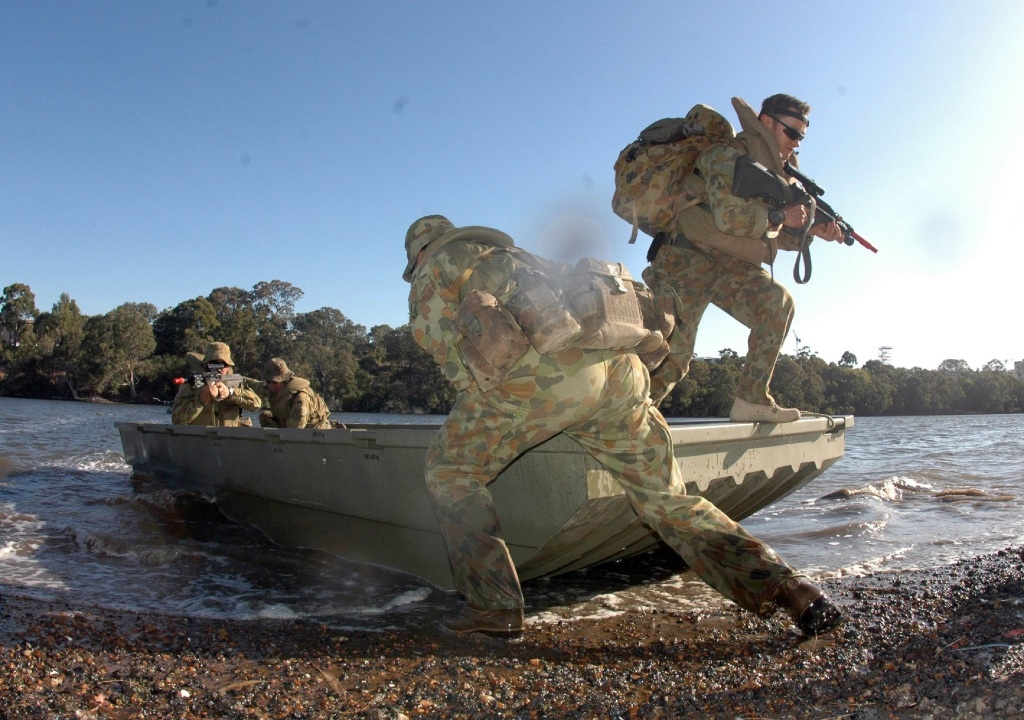 Lance Corporal Jason Griffiths holds the bow as Lance Corporal James Gilmour disembarks.