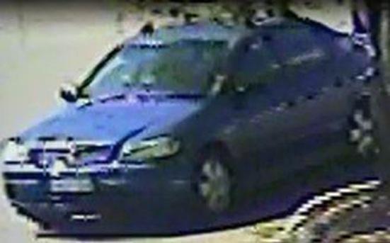 The CCTV image of the blue Holden hatchback.