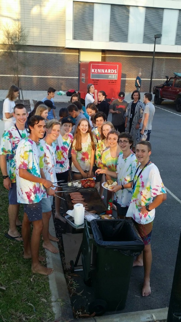 Students celebrate their success with a barbecue event.