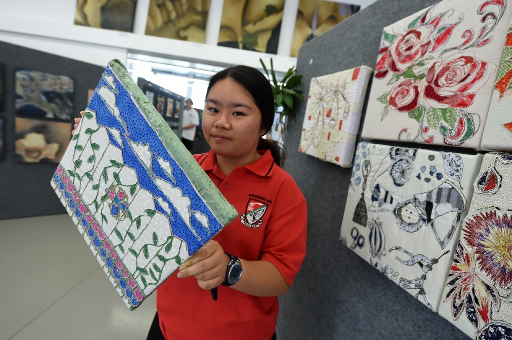 Year 8 student Hugo Wai. Pictures: Jon Hewson www.communitypix.com.au   d446686Year 10 student Elizabeth Tan with one of her artworks.