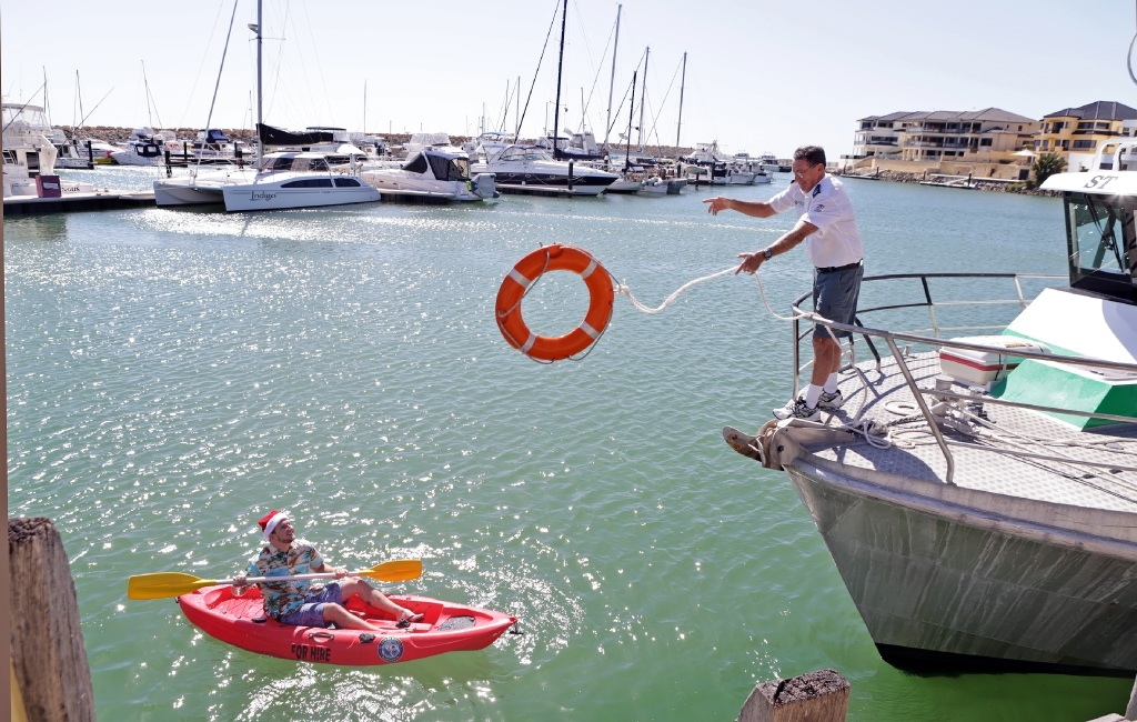 Mindarie Marina's Alex Bowen and Whitfords Volunteer Sea Rescue volunteer Warren Baker prepare for this weekend's Christmas Festival at Mindarie Marina.Picture: Martin Kennealey        www.communitypix.com.au   d447258