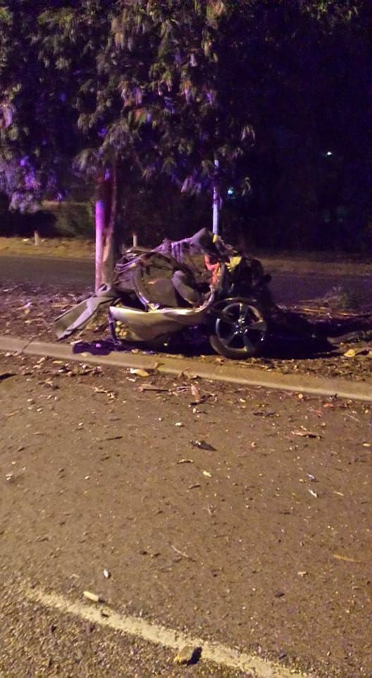 A Holden Calais was split in half after colliding with a tree last night. Picture supplied – Marcus Downs