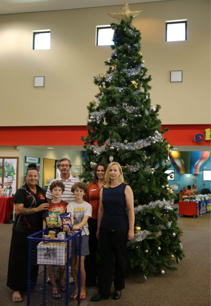 Owen and Lindsey Murrell, who donated to the Food For Fines campaign, with Tanya Cairns, from HAND, Andrew Jones, from True North Church, Kyla Rasmussen, from Spiers Centre, and Joondalup librarian Grace Beccarelli.