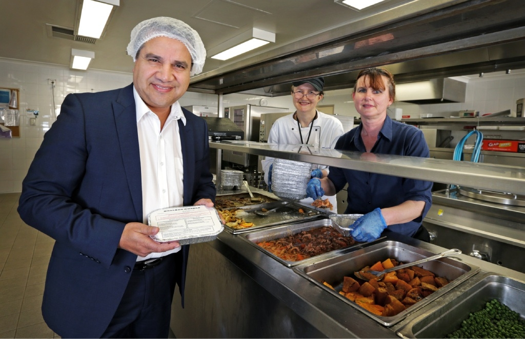 Former City of Bayswater Mayor Sylvan Albert in the kitchen at the City's hostel with                               assistant chef Rosie Warren and chef manager Diane Gregorie.  Picture: David Baylis           d442133