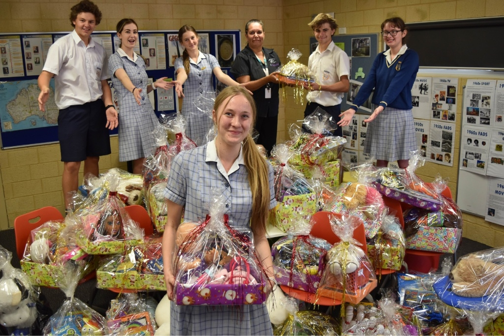 Mandurah Baptist College students, including Jacinta Rowe (front), presented gift baskets to Katie Bennell from the Aboriginal Outreach Team at Nidjalla Waangan Mia.