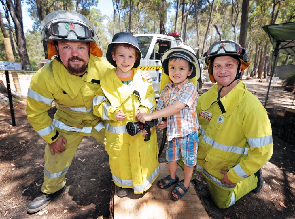 Bianca Frameneau and Abigail Willard (both 4) enjoyed the habitat.Stephen Barratt and Daron Casparis of Parkerville Volunteer Bush Fire Brigade with Lucas Charleton (4) and Aiden Jury (4).        www.communitypix.com.au   d447014Kindy teacher Caroline Whitelock and Ryan Solly (5) on the rope bridge.
