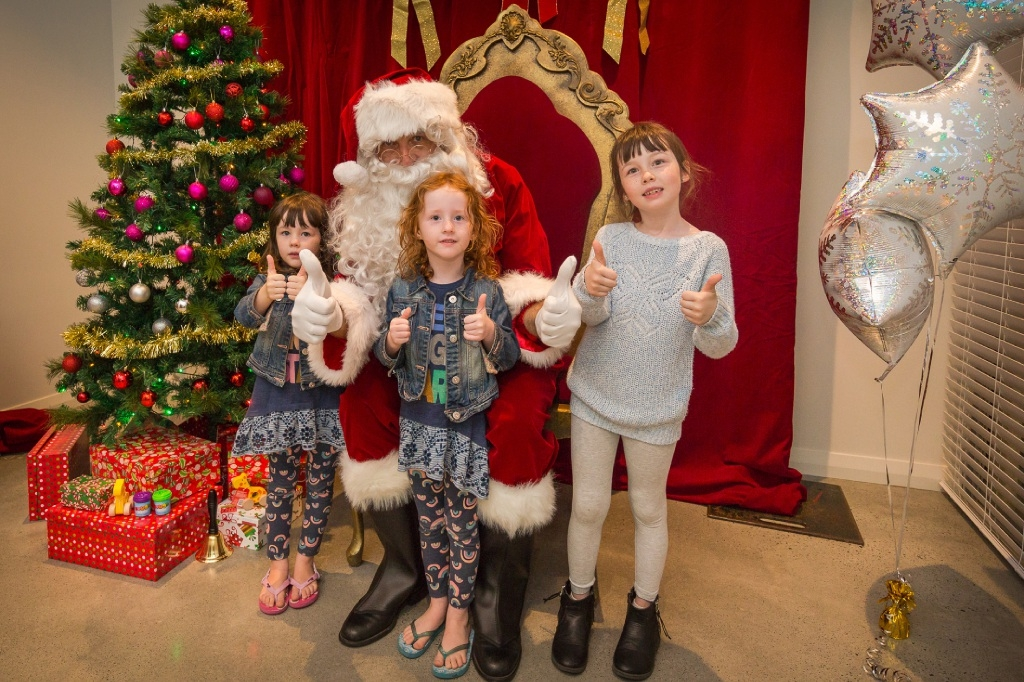 Lucy, Florence and Neave Williamson with Santa. Right: Tyler, Lily, Alicia, Anton and Jayden Wright with Santa.