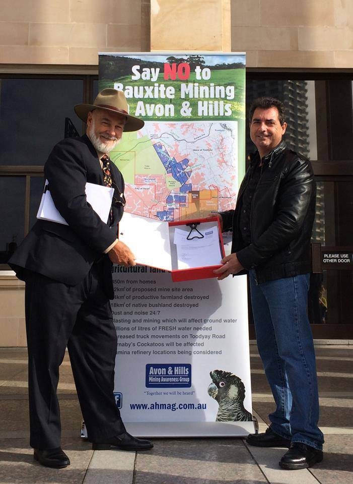 Robin Chapple receives the first anti-mining petition from AHMAG President Brian Dale in August.