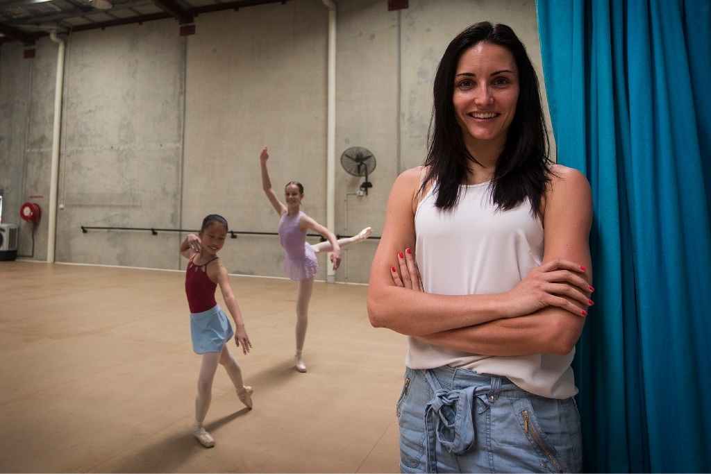 Well-positioned for the future: Young ballerinas Aimee Yong (10) and Kelly Devlin (14) with their coach Katharine Mantle.  Picture: Will Russell           d447599