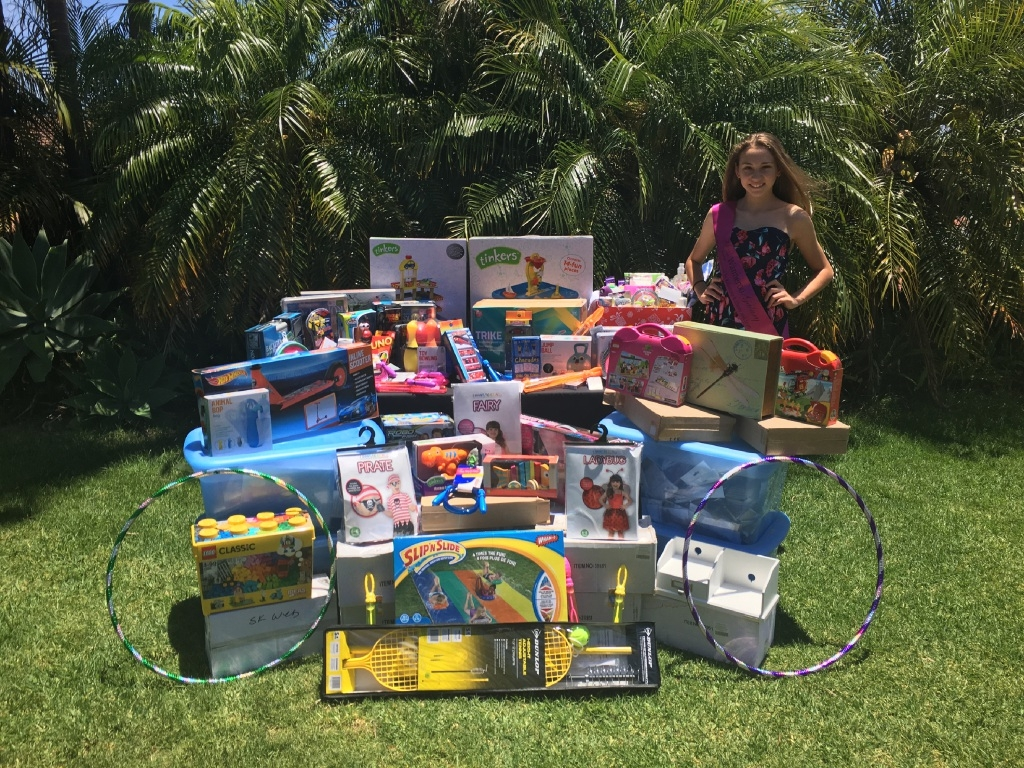 Alicia Tavani with the hamper of gifts for the Telethon Type 1 Family Centre.