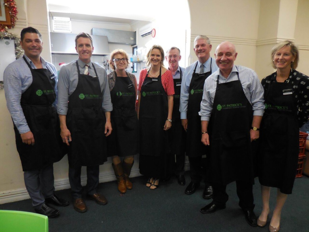 Fremantle and Cockburn representatives help out at the St Patrick's Community Support Centre Christmas lunch.