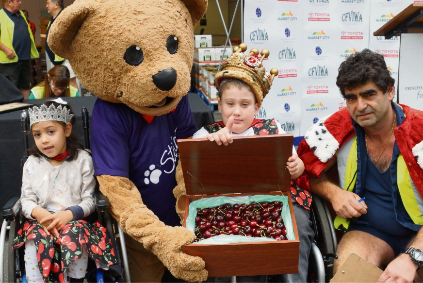 Ruby, Stitches the Bear, Riley and this year's Cherry King Tony Galati.