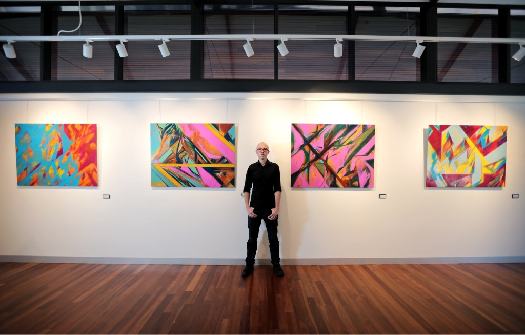 Ronan Lane of Kalamunda with his abstract paintings on aluminium.  Picture: David Baylis         www.communitypix.com.au   d447738