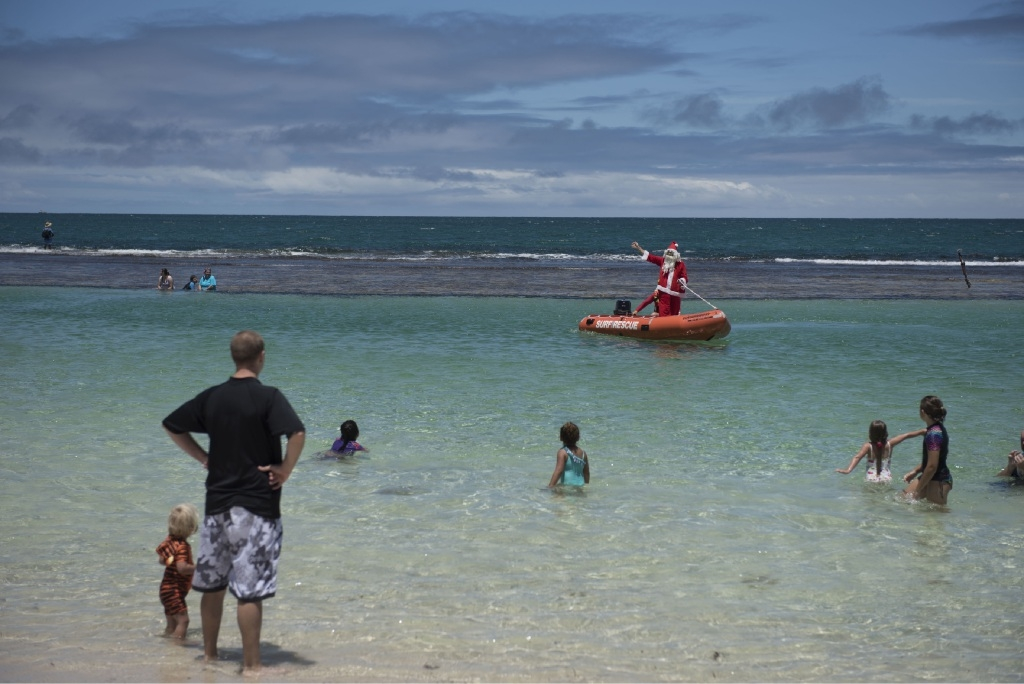 Santa arrives in Yanchep via surfboat.Picture: Carlos Arevalo Photography
