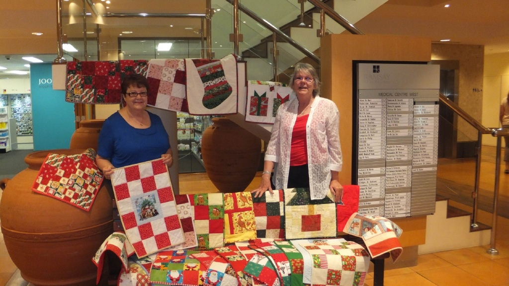 Teacher Liz Burrowes (left) and quilter Ally Crabtree with the quilts.