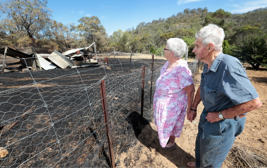 Shirley and Keith Robinson, of Gidgegannup, seen here at the edge of the fire front that nearly reached their home.Picture: David Baylis www.communitypix.com.au   d447965