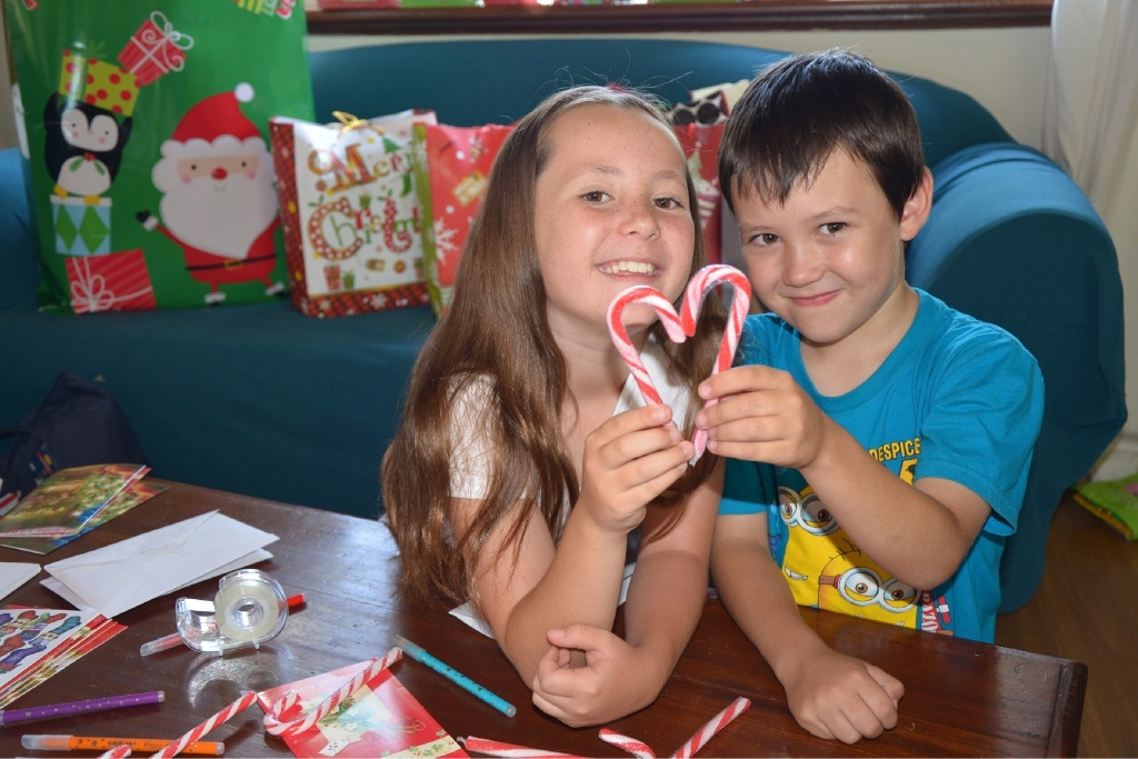 Ameerah and Aiden Harpley prepare candy canes for the homeless this Christmas.