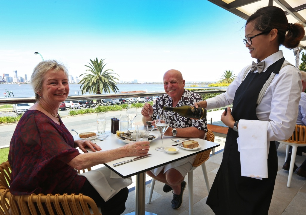 Local residents Anne Boys and Tony Glass are served by Venice Molo at Rambla On Swan in South Perth.Graham Hardie and Hugh Brown at Rambla On Swan. Picture: Matt Jelonek                   d447590