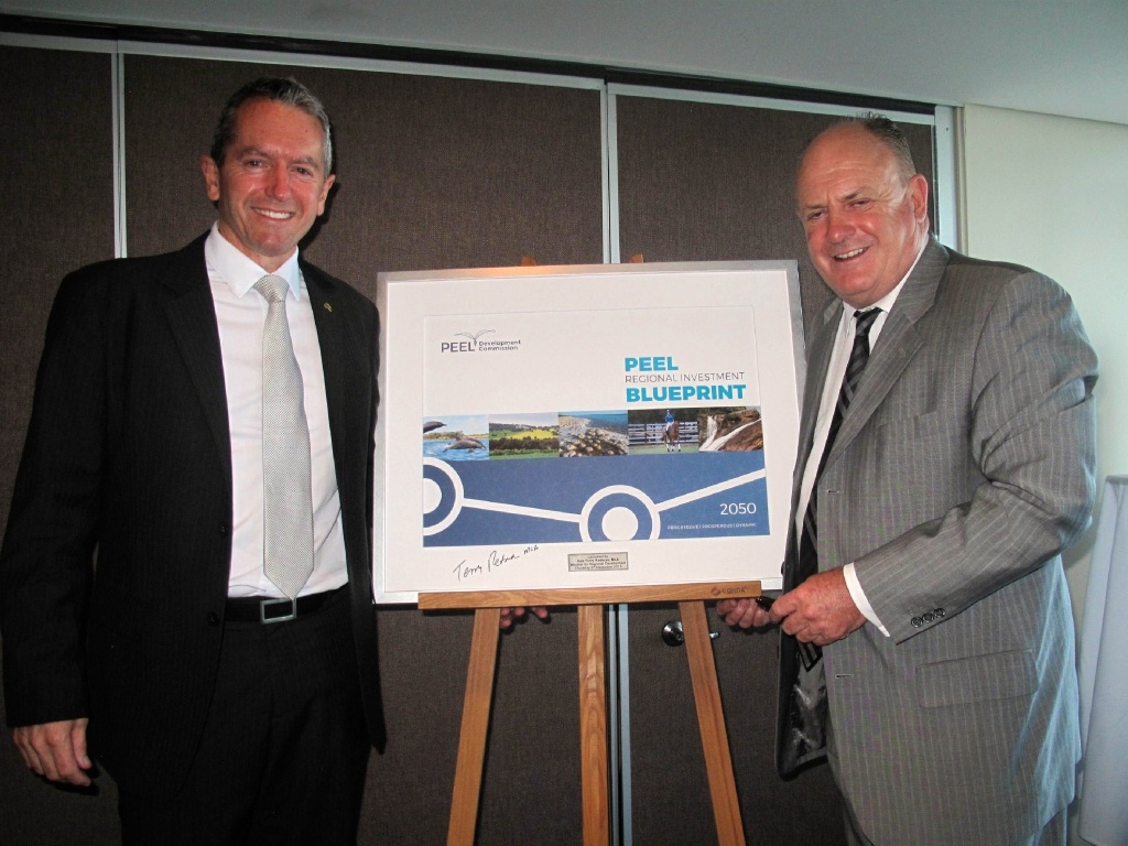 Regional Development Minister Terry Redman and Peel Development Commission chairman Paul Fitzpatrick with the blueprint.