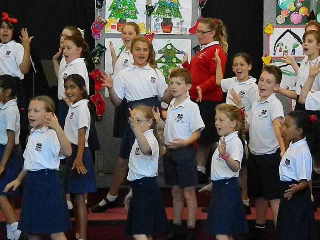 Students singing Christmas carols for their visitors.