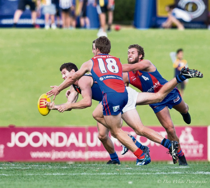 Jay van Berlo and Luke Meadows pressure Pat McGinnity. Picture: Dan White
