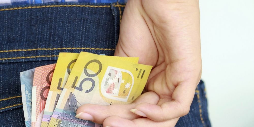 A woman has been charged over business theft. Picture: stock image
