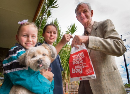 Lacinta and Cloe Blakers answer the appeal from Red Cross volunteer Barry Kilsby.