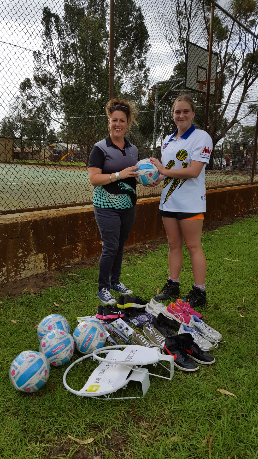 Northern Jaguars Netball Club president Olivia Grose with Kirsten Mellows.