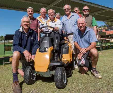 Keith McMillan Brown and club members with the new ride-on mower he provided.