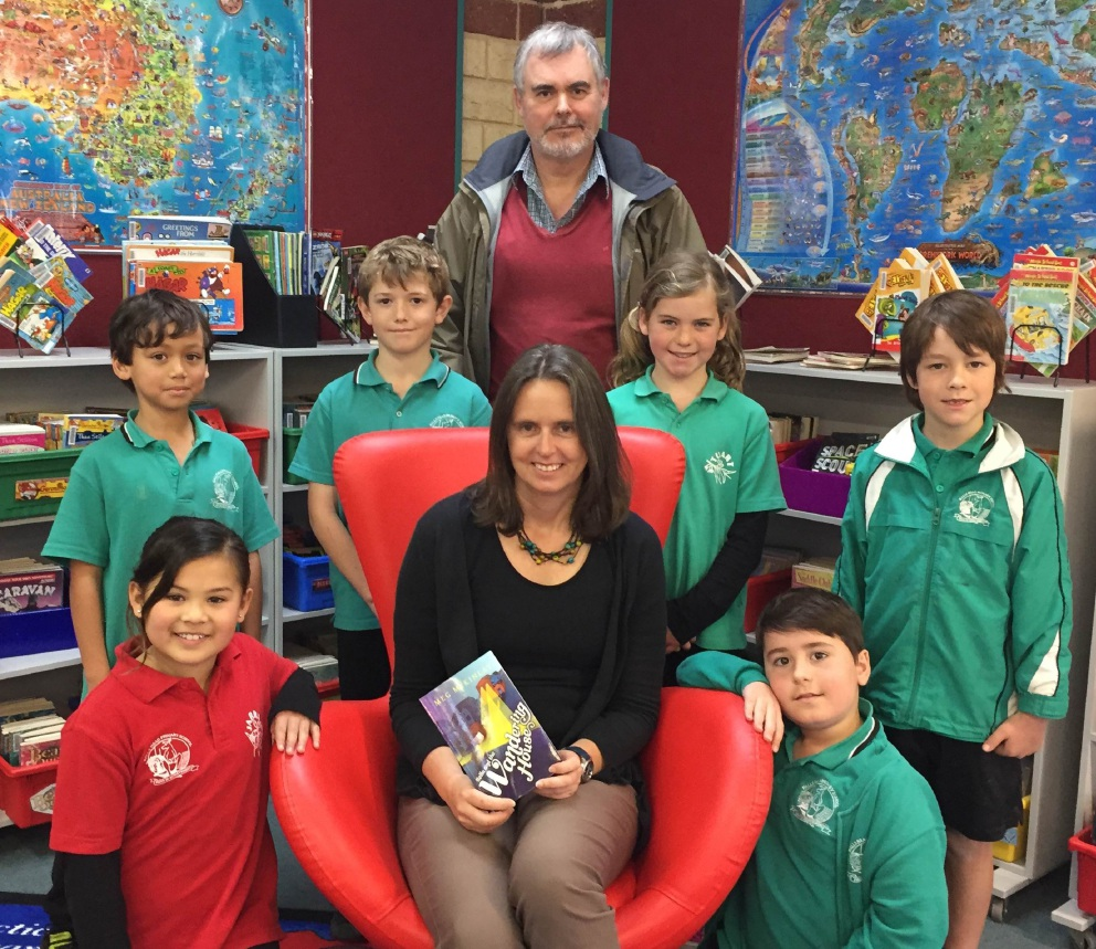 Author Meg McKinlay (middle), Halls Head Primary School students Lisa Herbert, Bijan Searle, Nicholas Somerford, Mia Pedrana, Cory Flemming and Lachlan Latta and Rotary Club member Malcolm Campbell.