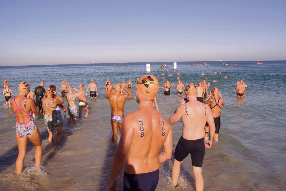 Perfect conditions attract big field for new open water challenge at Leighton Beach