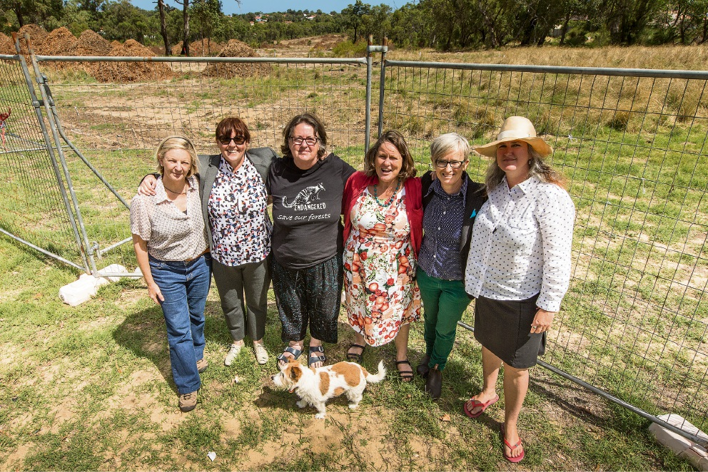 Rethink the Link's Kim Dravnieks, Community Wildlife Corridor member Suzanne Smith, Save Beeliar Wetlands' Felicity Bairstow, Rethink the Link's Anita Straude with Rosie (dog), Community Wildlife Corridor member Nandi Chinna, and Save Beeliar Wetlands' Kate Kelly celebrate the halt to work on Roe 8.