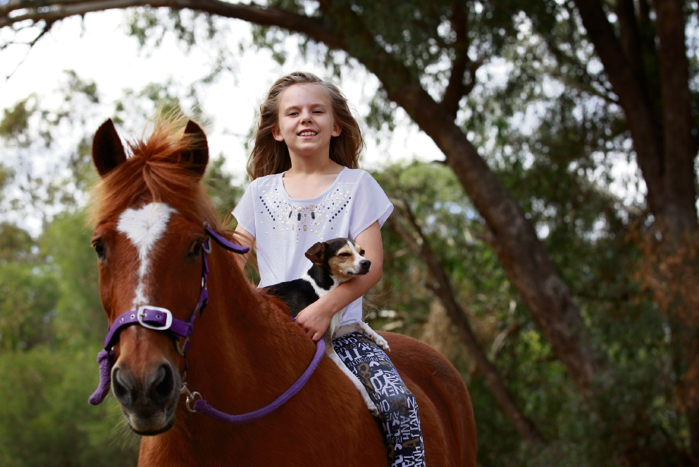 Katie Birss (8) with her horse Miss Molly and dog Prince at the family farm in Haynes. Picture: Marie Nirme