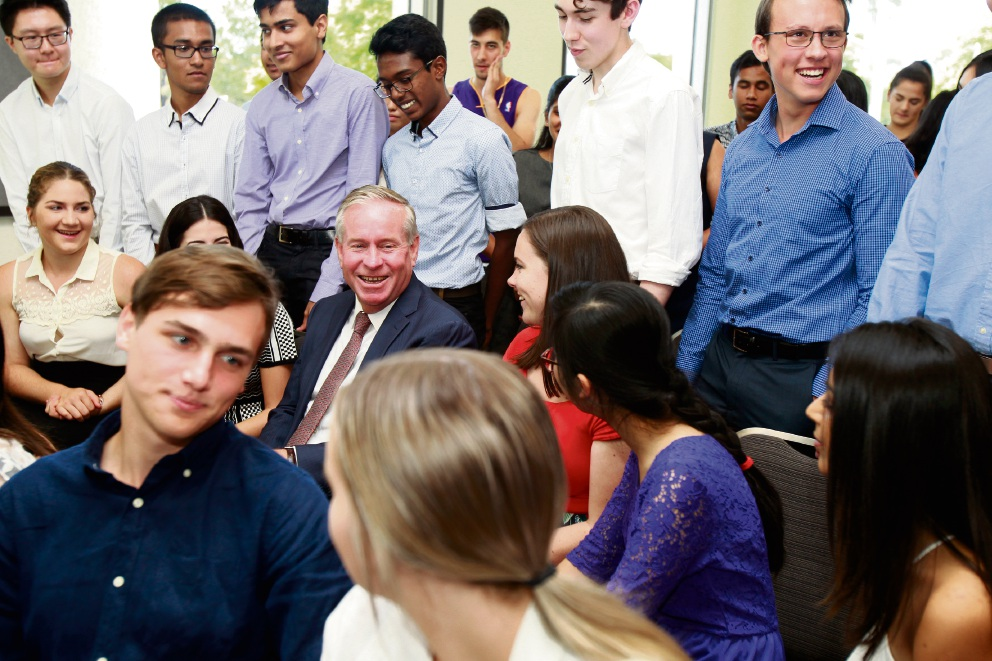 Colin Barnett chats among the new students.