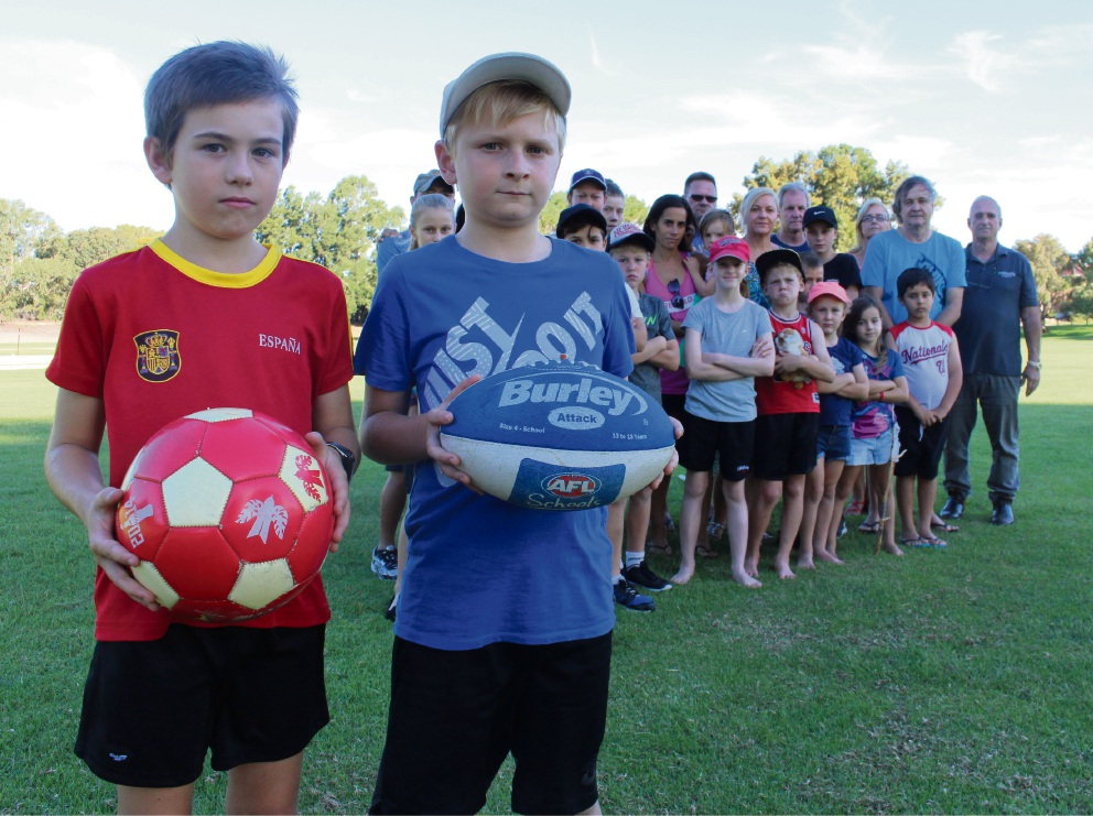 Xabi Bell (8) and Jay Harrison (9) are among the Murdoch residents upset about a turf wicket recently installed at Bert Jeffrey Park.