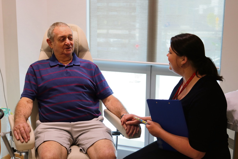 Patient Graham McLure with St John of God nurse Emma Lacey.