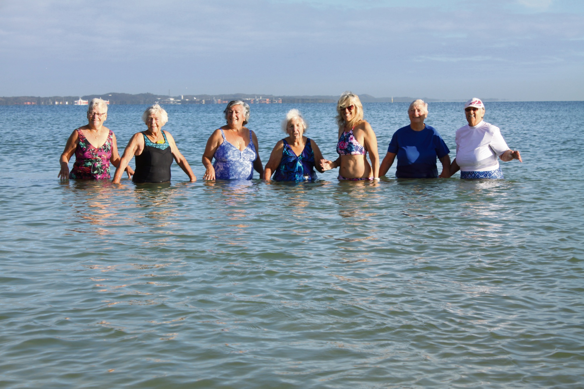 Come rain, hail, shine - or hip replacement - the swimmers show up for their regular time together in the ocean.