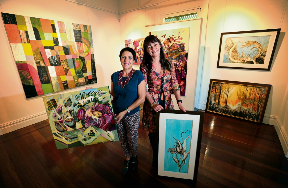 Magda Joubert and Sandie Schroder preparing for the exhibition. Picture: David Baylis        www.communitypix.com.au   d467404