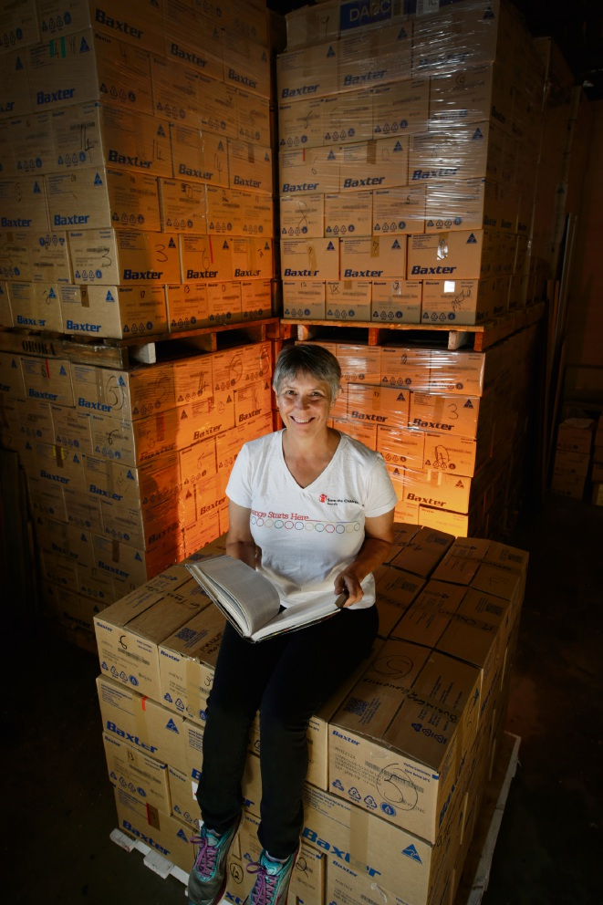Anthea Fellowes with boxes of books for the Save the Children book sale. Picture: Andrew Ritchie    d467275