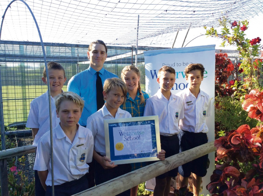 St Damien's Catholic Primary School students Rusty McGowan, Charlie Baker, Mr Mark Lilly , Brodie Garbujo, Zoe Scott, Hunter Reid and Matthew Hutchinson with school Waterwise co-ordinator Mark Lilly.