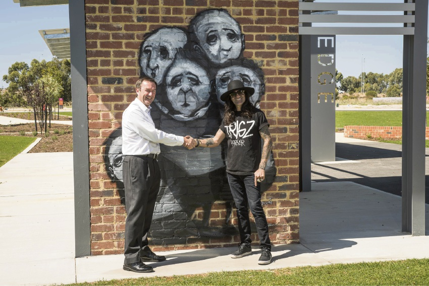 Street artist Stormie Mills and Perron Developments development manager Lyle Kenny.