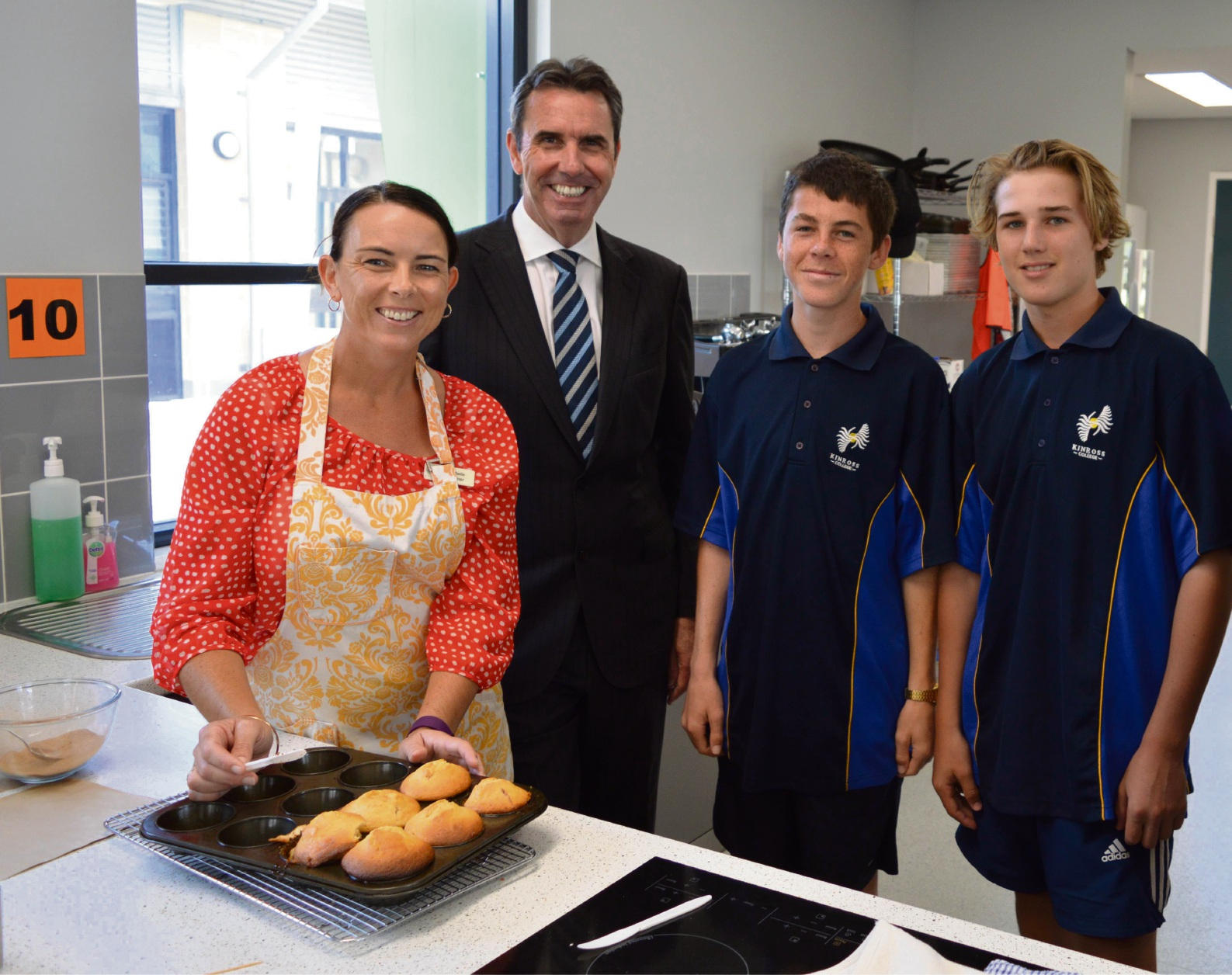 Home economics teacher Michelle Downer, North Metropolitan MLC Peter Collier and students Daniel Morgan and William Woodhall in the food studio.